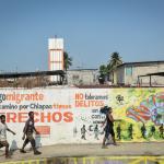 imagen de un mural alertando sobre los derechos de las personas migrantes