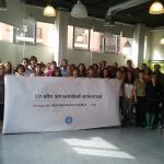 Equipo de Médicos del Mundo España exigiendo la derogación del Real Decreto 16/2012.